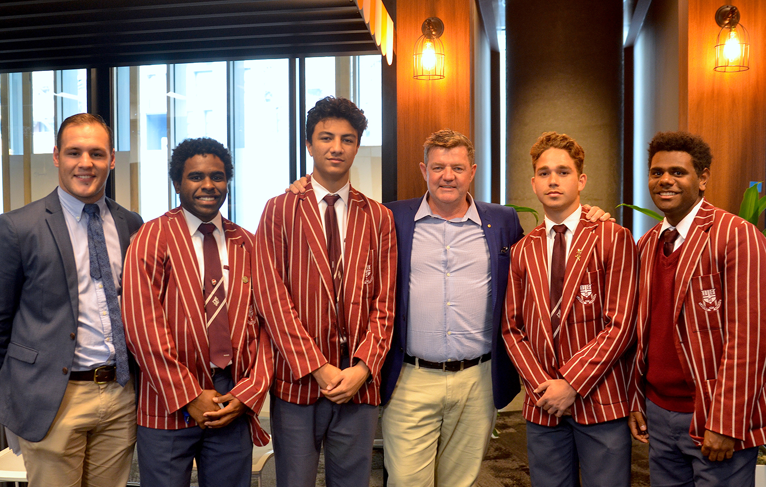Khalu (far right) with AIEF Executive Director Andrew Penfold, fellow 2018 AIEF Scholarship Graduates John, Traeden and Thomas, and Ipswich Grammar School Indigenous Support Officer Jackson Weir-White.